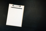 Notes clipboard with pencil and blank sheets of paper - 220009548