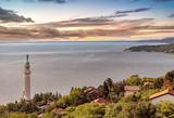Il golfo di Trieste, con il Faro della Vittoria e il Castello di Miramare durante un tramonto - 220020190