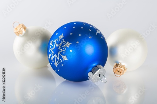 blue and white christmas baubles on the grey background - Blue Grey Christmas Decorations