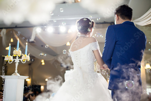 Behind The Groom And Bride During Standing On Stage At Wedding Image For