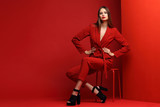 Fashion young woman in red suit. - 220048355