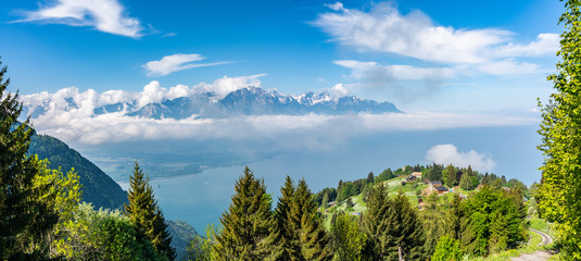 Switzerland, scenic view on Alps with fog, clouds near lake Leman © AlehAlisevich
