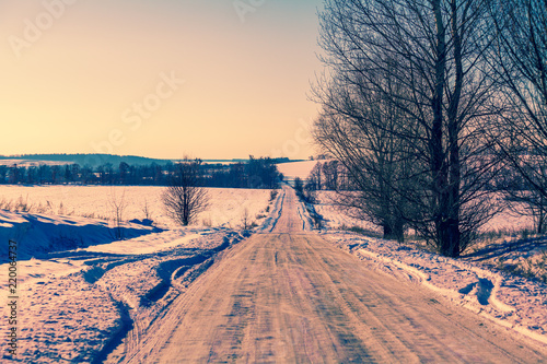 Fotoboard na płycie - Country road  covered with snow in evening