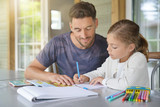 Daddy with little girl doing homework