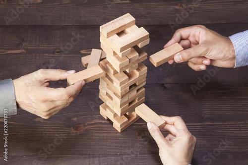 Leinwanddruck Bild Businessmen Builds a Tower