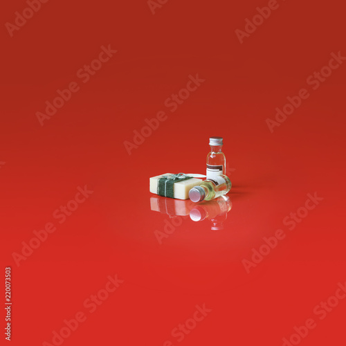 Spa soap, essential aroma oil, Spa theaphy concept products on the red reflection background