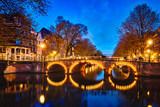 Amterdam canal, bridge and medieval houses in the evening - 220076102