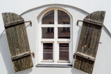 Old window with wooden shutters on white wall - 220077331