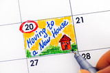 Woman fingers with pen writing reminder Moving to a New House in calendar. - 220083595