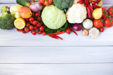 Fresh Vegetables and Fruits on a wooden background. - 220098140
