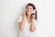 canvas print picture - Hübsche junge Frau mit Kopfhörern