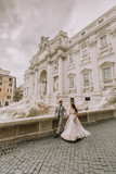 Bride and groom posing in front of Trevi Fountain (Fontana di Trevi), Rome, Italy - 220116164