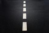 White dotted line on dark city asphalt road background. - 220148346