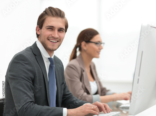 close up.smiling businessman with an assistant at the Desk - 220157957