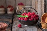 Rural still life with raspberries on rustic wooden  table