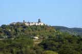 A long distance view across rural  Lot et Garonne countryside to the picturesque hilltop town of Tournon d'Agenais, France - 220206580