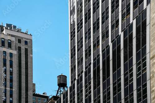 Foto Murales Low angle view of skyscrapers and water tank in New York