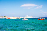 Fishing boats and voyage yacht near berth on the greece sea bay - 220208597