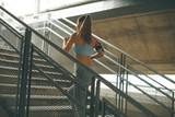 Young woman running alone up stairs