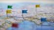 Leinwanddruck Bild - Locations marked with pins on world map, global communication network, closeup