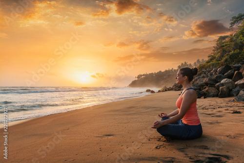 Poster Woman doing yoga at beach - Padmasana lotus pose