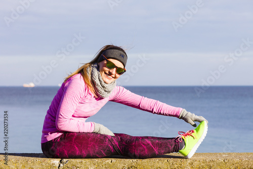 Wall mural Woman fitness sport girl training outdoor in cold weather