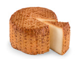 Round smoked cheese with segment cut angle view isolated - 220291743