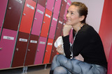 woman looking at the lockers - 220295176