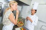 teacher tasting the fresh produce - 220299945