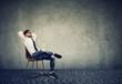 Leinwanddruck Bild - Man sitting on chair in relaxation