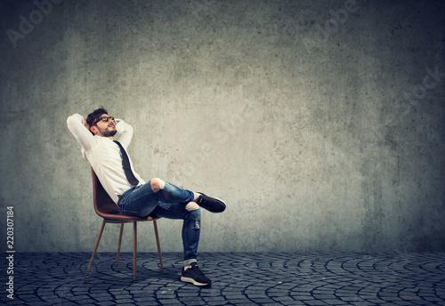 Leinwanddruck Bild Man sitting on chair in relaxation