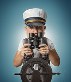 caricature of funny sailor captain holding binoculars and watching - 220307793