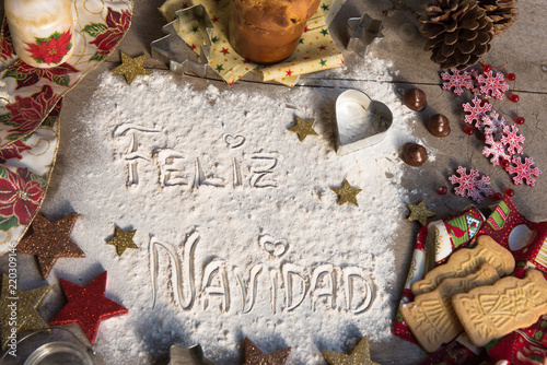 feliz navidad spanish text made with flour surrounded by christmas decorations - Spanish Christmas Decorations