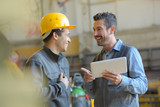 workers talking and laughing at a factory - 220309764