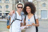 happy tourists sightseeing city with map - 220309968