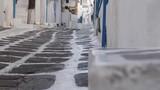 Greek laneway focus shift to cobblestone street - 220341982