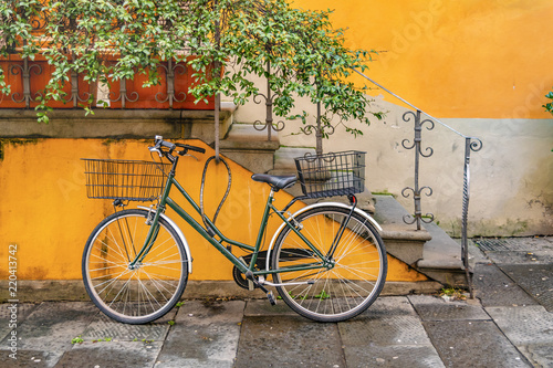 Fototapeta Bicycle Parked at Wall, Lucca, Italy