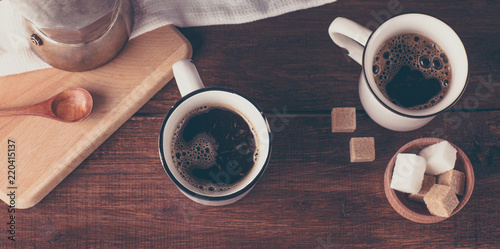 two coffee mugs and sugar, top view, long banner
