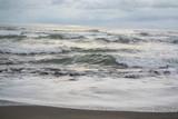 beach with dark sand - 220420711