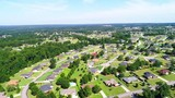 Overhead drone footage of neighborhood  in early afternoon. - 220429705