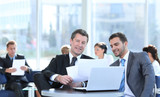 business partners discuss financial issues sitting in the lobby of the Bank - 220429933