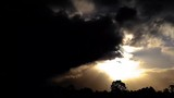 Dark winter sunset panning hyperlapse with gathering clouds - 220436308