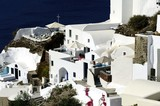 White houses clinging to the cliff tops - 220438109