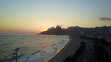 Camera movement >  forward Phantom 4 DJI drone  in  the streets of Ipanema Rio de Janeiro Brazil, during one summer sunset moving towards the ocean - 220446508