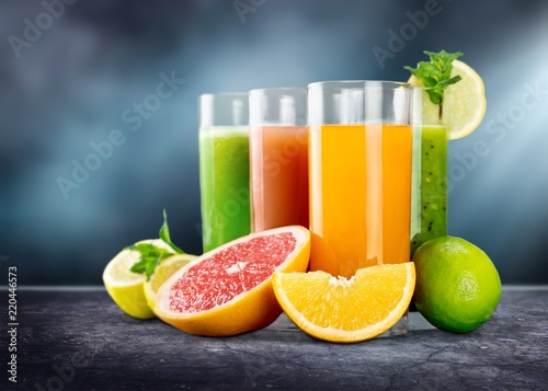 Leinwanddruck Bild Tasty fruits and juice on wooden table