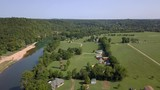 aerial view of country homes by a river - 220460198