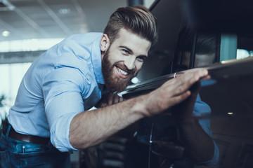 Portrait of Handsome Buisiness Man Enjoying Car