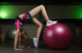 schoolgirl trains in the gym Pilates in the fitness club - 220482906