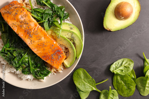 salmon with spinach and avocado - 220490522