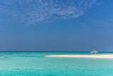 Amazing blue water in a desert island, blue sky day, wood hut - 220534735